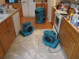 water damage photo of two air movers and one stand up dehumidifier; the water removal drying process